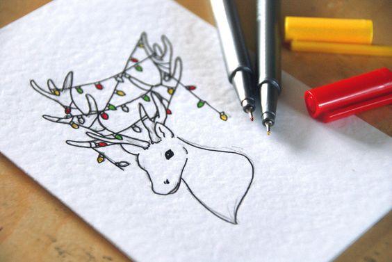 Tarjeta navidad dibujo a mano de un ciervo con lucecitas de navidad