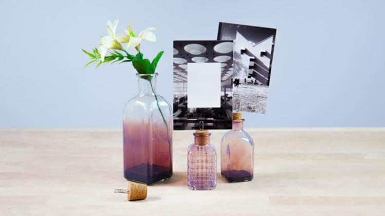 Portafotos hechos con botellas de vidrio