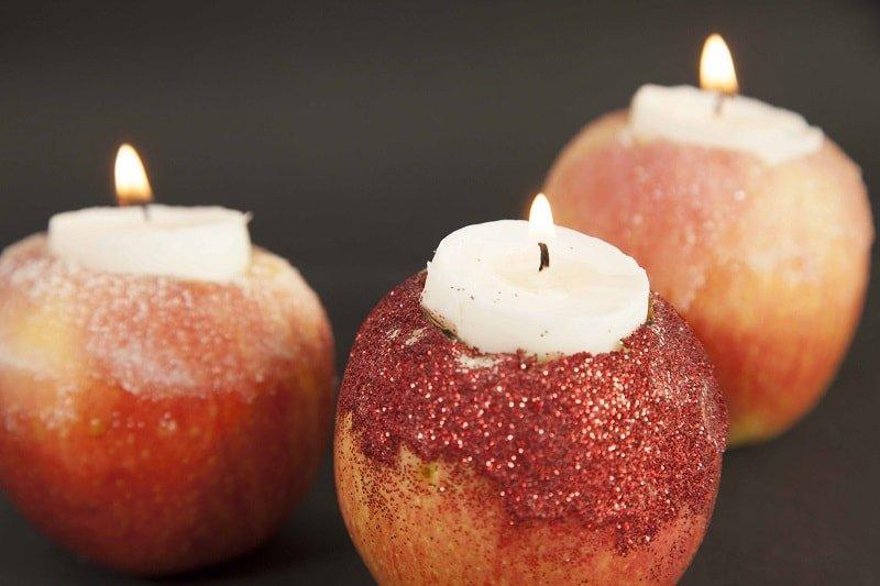 Portavelas hechos con manzanas