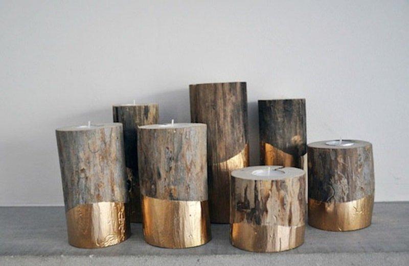 Portavelas con troncos y toques dorados