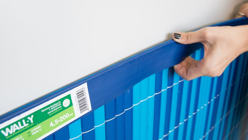 Colocación de la banda protectora del panel decorativo