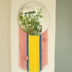Cómo decorar un espejo con lana