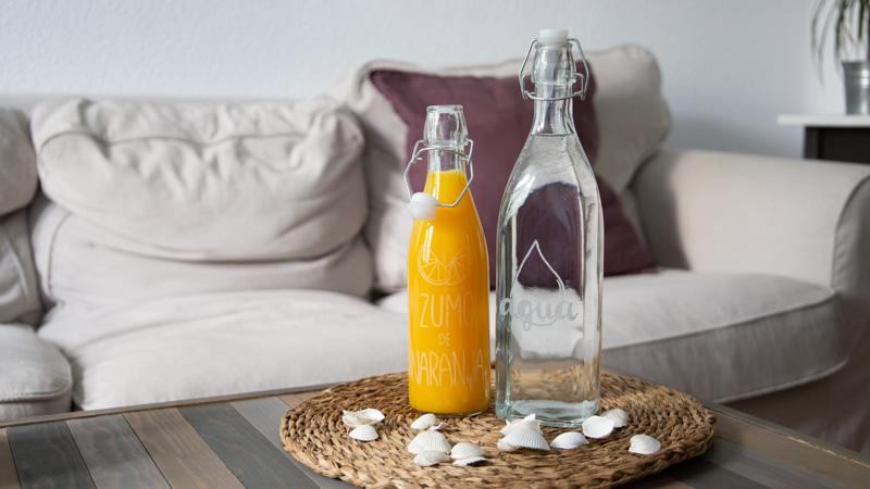 Cómo hacer botellas de vidrio decoradas con grabados