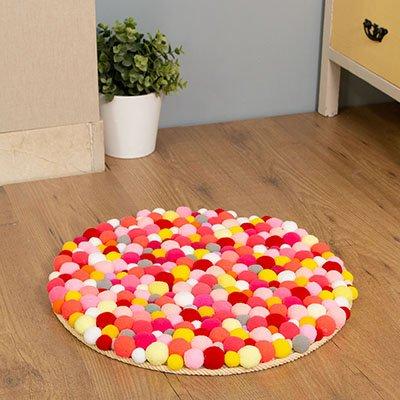 Cómo hacer una alfombra con pompones