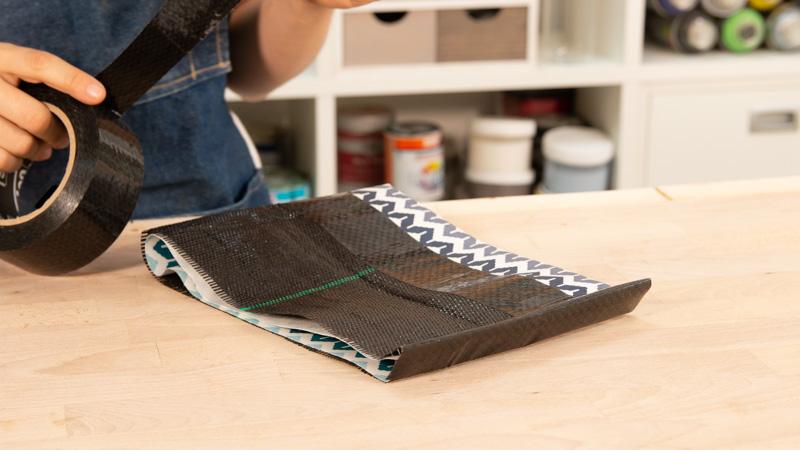 Extremos de las telas unidos por la cinta impermeabilizante