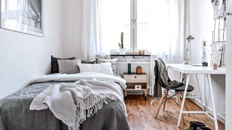 Dormitorio con una paleta de colores clara