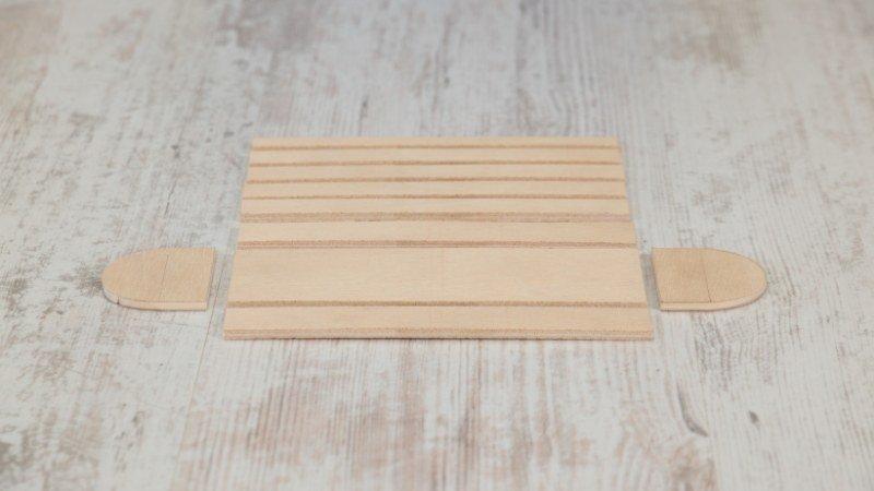 resutlado de las piezas cortadas para comenzar a lijarlas y montar la cajita de madera flexible